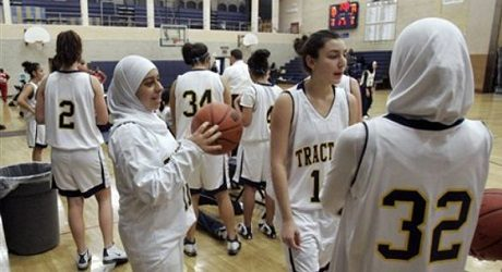** ADVANCE FOR WEEKEND EDITIONS, DEC. 15-16 **Fordson High School basketball player Fatima Kobeissi, left and teammate Hyatt Bakri (32) wait before the basketball game against Willow Run in Dearborn, Mich., Tuesday, Dec. 4, 2007.   As more covered Muslim girls take up competitive sports, supporters say it's time to get beyond merely allowing the hijab _ or traditional Muslim headscarf worn for modesty _ and help make those wearing them feel welcome.    (AP Photo/Carlos Osorio)